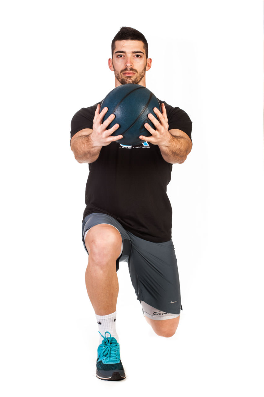 Medicine Ball Lunge with Torso Rotation frame #2