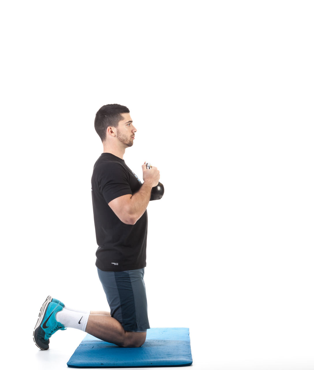 Kettlebell Kneeling to Stand-Up frame #1