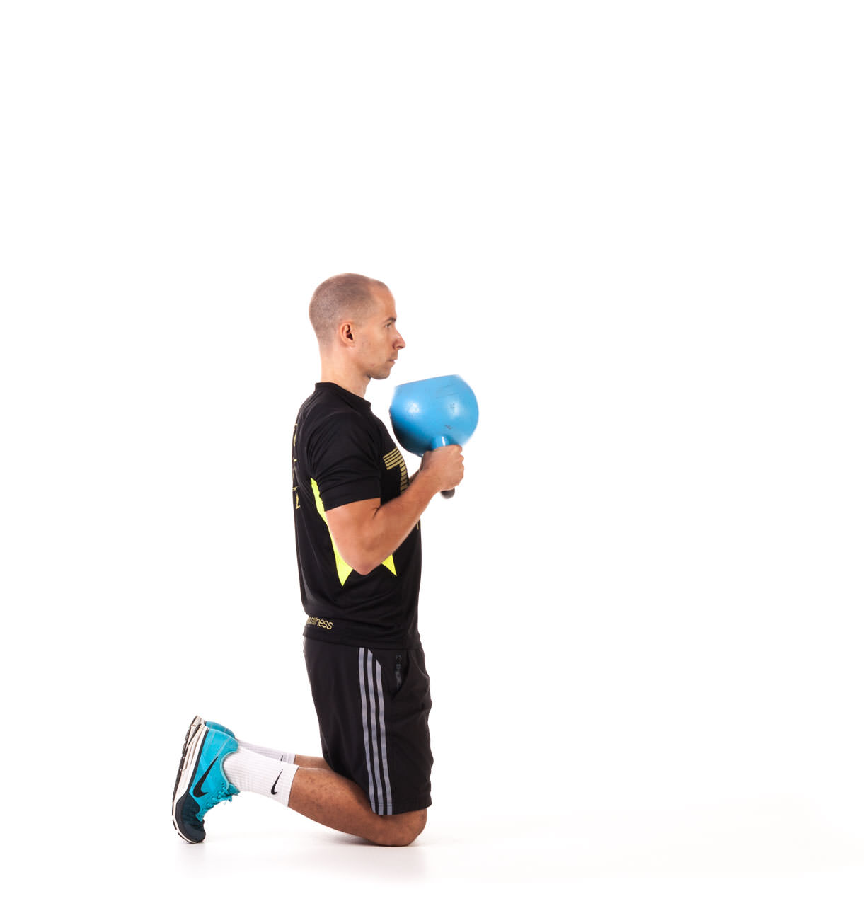 Kettlebell Kneeling to Stand Up frame #1