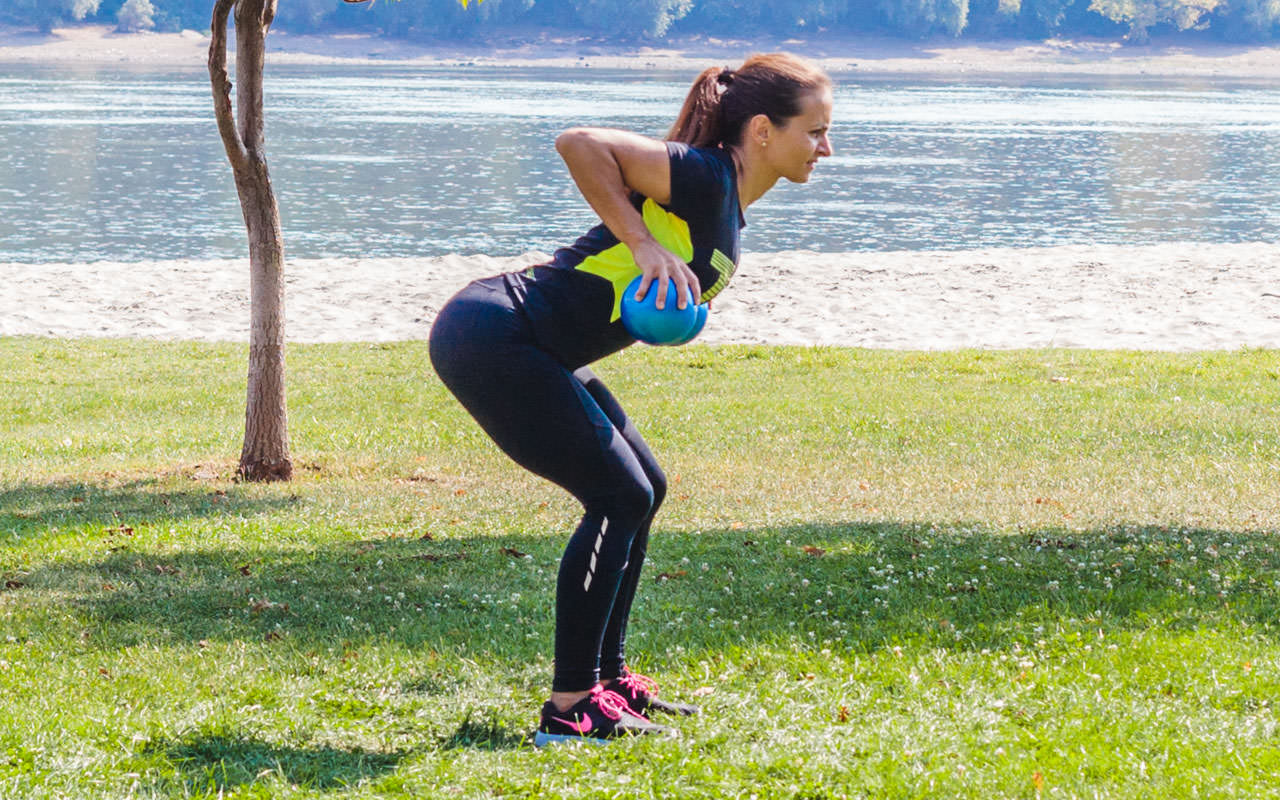Bent Over Two-Medicine Ball Triceps Extension frame #1