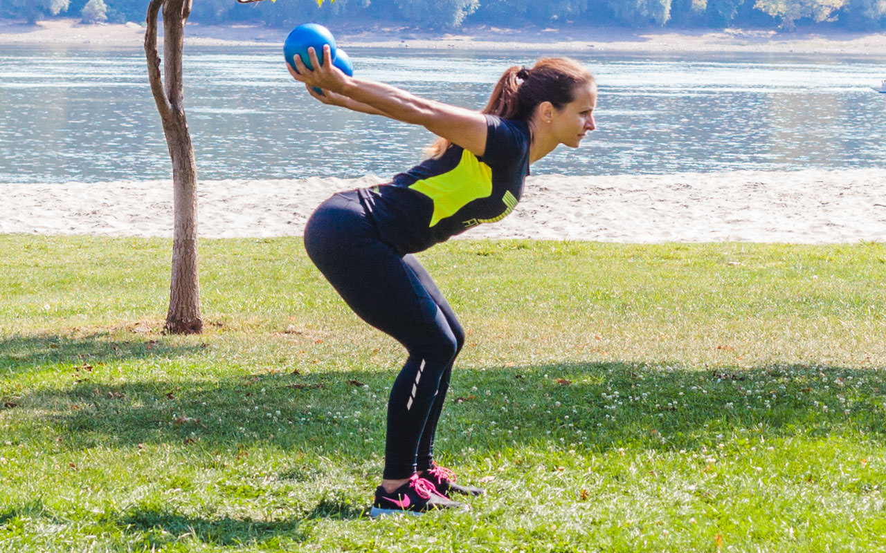 Bent Over Two-Medicine Ball Triceps Extension frame #2