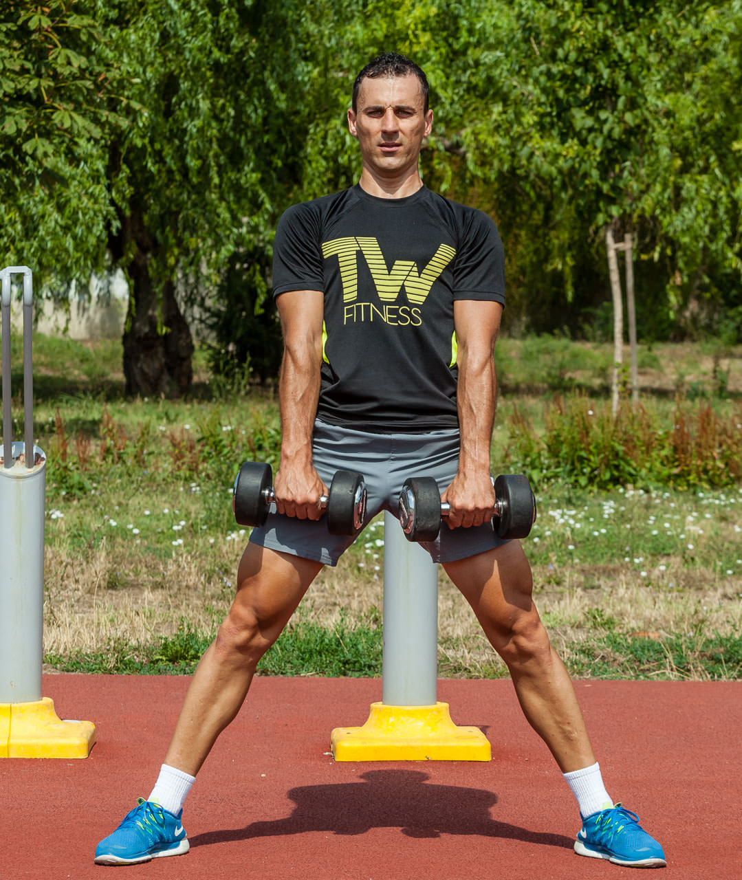 Dumbbell Sumo Deadlift | Total Workout Fitness